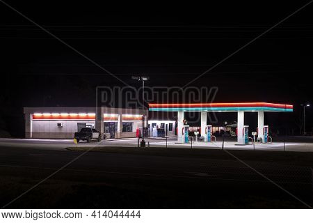 Horizontal Shot Of A Small Unbranded Rural Gas Station With Copy Space Top And Bottom.