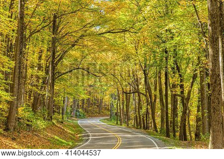 Horizontal Shot Of A Smoky Mountain Road With Beautiful Fall Foilage.  This Is A Revised Image.