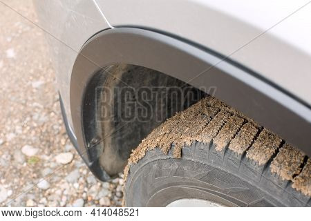 Wheel In A Swamp Under The Wing Of A Suv Off Road Extreme Ride, Close-up Of A Tire With A Tread And