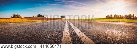 Wide Asphalt Road Panorama In Countryside On Summer Day.