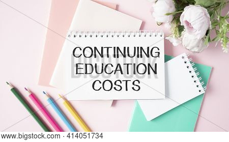 Continuing Education Costs Text Write On A Book Isolated Wooden Table.