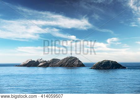 Seascape with lighthouse on the isle Muckle Flugga