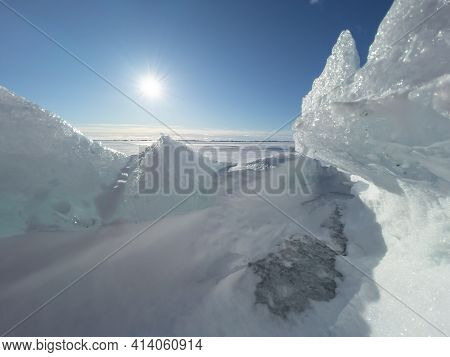 Ice Slopes In Sunny Winter Day, Transparent Ice Of Blue Color, Purely Blue Sky, Long Shadows, A Pure