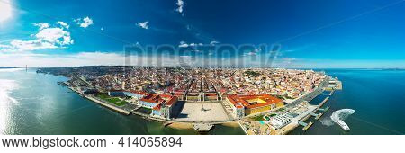 Aerial Panoramic View Of Lisbon City Coast And Old Town At Sunny Summer Day. View From Tagus River.