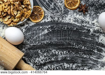 Bakery Background. Cooking Food Ingredients: Flour, Eggs, Nut And Star Anise, Orange On Dark Table K