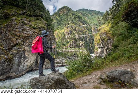 Tourist Woman Looking To Tenzing-hillary Suspension Bridge, The Bridge Build For Crossing The River