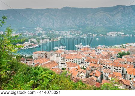 Kotor Bay And Terracotta Tiled Rooftops Viewed From Above The Old Town,kotor,montenegro.
