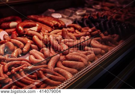 Refrigerated Counter Filled With Quantity And Different Sausages