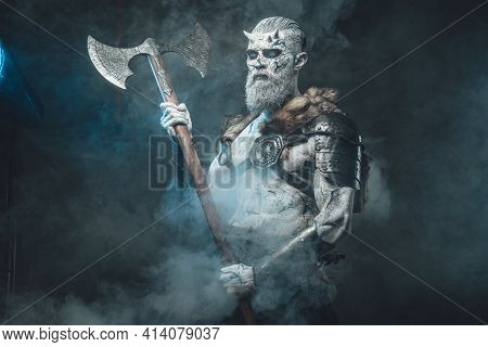 Nordic Warlike Undead With Hatchet In Smokey Background