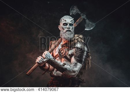 Winter Undead Chief From North With Hatchet In Dark Background