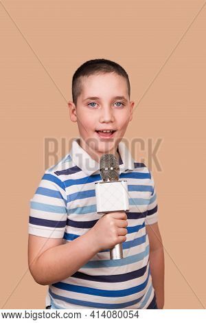 Talented Child Sings Karaoke. Young Boy Is Recording His Song In The Studio. Cut Child Performs. Boy