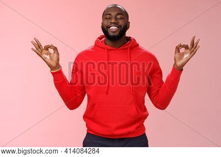 Happy African American Bearded Man In Red Hoodie Meditating Found Peace Nirvana Smiling Delighted Cl