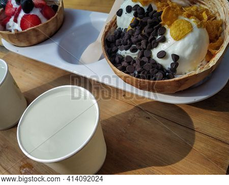 Various Colorful Ice Cream Balls With Chocolate, Scoops Of Creamy Specialty Ice Cream In Assorted Fl