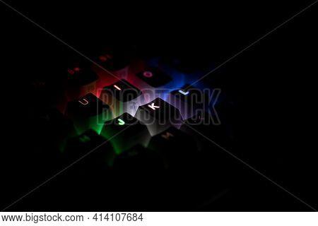 Side View Detail Closeup Of Illuminated Rgb Keycaps Keys On Black On Black Gaming Keyboard Shining I