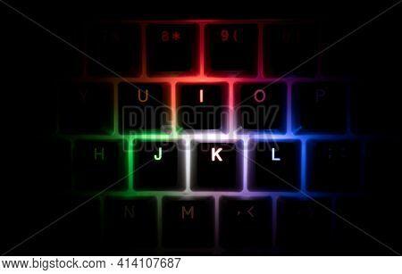 Top View Detail Closeup Of Illuminated Rgb Keycaps Keys On Black On Black Gaming Keyboard Shining In