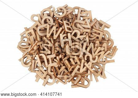 Top View Closeup Detail Of Pile Of Wooden Cut Small Alphabet Letters Isolated On White Background