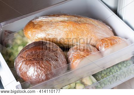 A Loaf Of Wheat Bread And Other Frozen Food On A Shelf Of A Home Freezer, Big Procurement And Food S