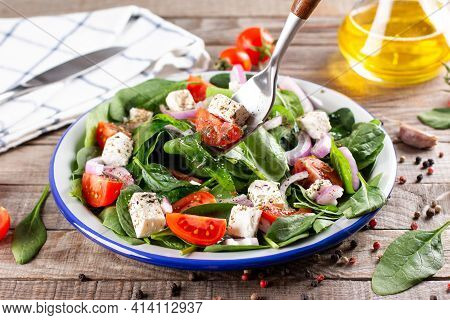Spring Vegan Salad With Spinach, Cherry Tomatoes, Baby Spinach, Feta Cheese And Red Onion On A Woode