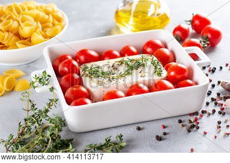 Cooking Baked Feta Pasta. Raw Ingredients Before Cooking: Pasta, Feta Cheese, Olive Oil And Cherry T