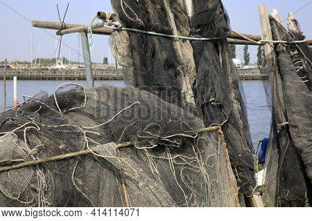 Po River (fe),  Italy - April 30, 2017: Pots And Nets Near Po River, Delta Regional Park, Emilia Rom