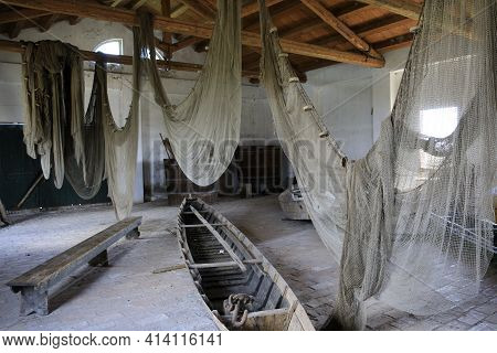 Po River (fe),  Italy - April 30, 2017: Nets And Boat Into An Old Fisherman\\\'s House On Po River,
