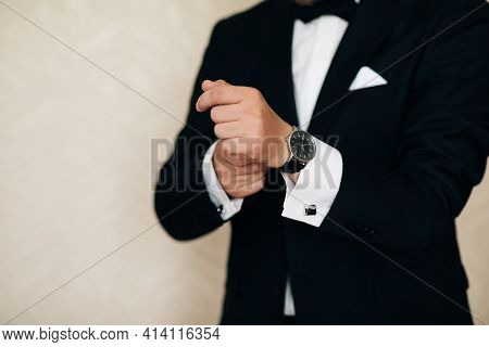 Businessman Adjusts His White Shirt Button. Concept Successful Businessman. Portrait Of Trendy Attra