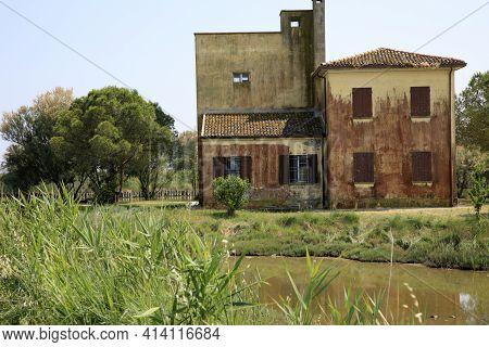 Po River (fe),  Italy - April 30, 2017: An Old House Near Po River, Delta Regional Park, Emilia Roma