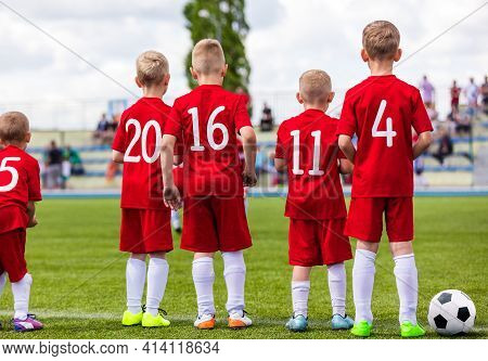 Group Of School Boys On Soccer Game Standing Along Sideline And Watching Competition. Football Tourn