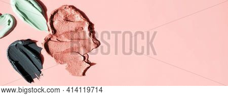 Various Facial Clay Cosmetic Masks Smudge On Pink Background With Copy Space Horizontal Banner Forma