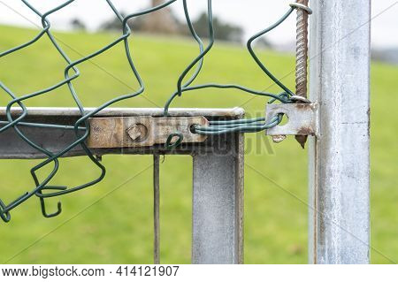 Mesh Chain Link Fence Fastening Close-up.