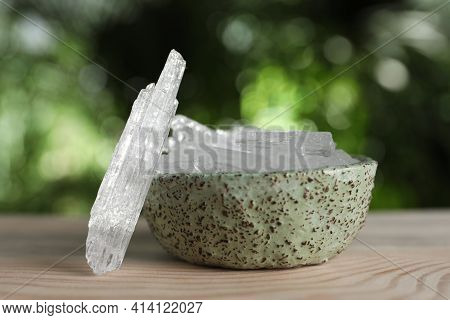 Menthol Crystals On Wooden Table Against Blurred Background