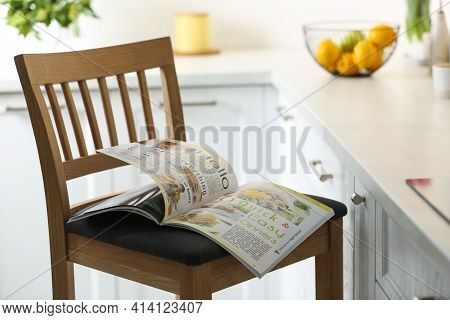 Open Culinary Magazine On Chair In Kitchen