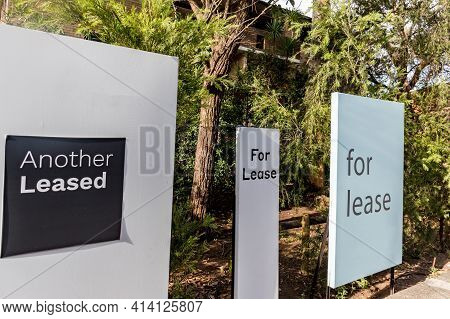 For Lease Signs Outside Of A Residential Building In Australia. Renting Market