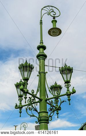 Vintage Rusted Green Lighting Pole With Cloudy Sky In The Background On Liberty Bridge (szabadság Hí