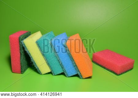Sponge For Washing Dishes And Plumbing On A Green Background. Detergents For Kitchen For Cleaning, T