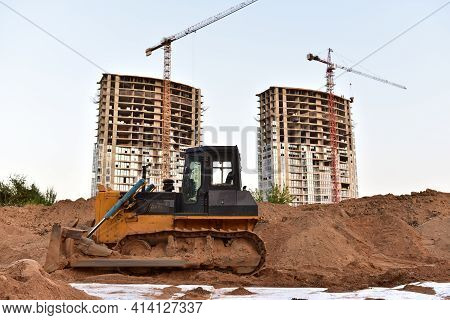 Dozer On Earthmoving At Construction. Construction Machinery And Equipment On Groundwork. Bulldozer