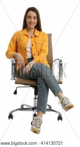 Young Woman Sitting In Comfortable Office Chair On White Background