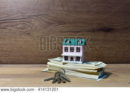 House And American Dollars. Home Buying Or Selling. Building On Credit Housing Or Renting An Apartme