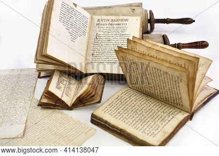 Lviv, Ukraine - April 2, 2020: Still Life With Ancient Books. Old Religious Slavonic Books With Anci
