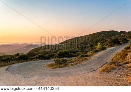 Winding Mountain Road Curve On Corfu Island In Greece At Sunset. Beautiful Landscape View Of Hills A