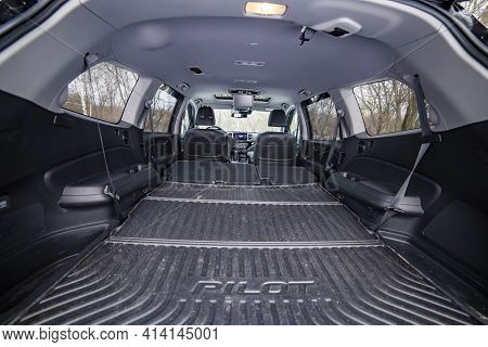 Moscow, Russia - February 2, 2020: Huge Luggage Compartment Of A Honda Pilot. Empty Interior Of New