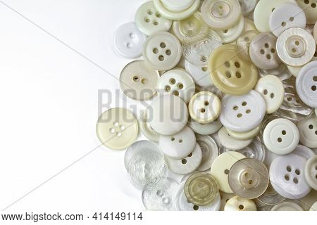 White And Beige Buttons On A White Background. Old Vintage Buttons Close Up. Copy Space. Top View. T