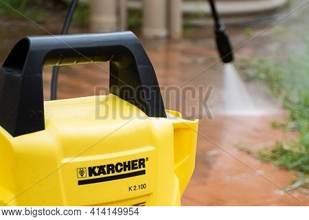 Selective Focus. Sydney, Australia - 2020-10-18 Cleaning Backyard Paving Tiles With Karcher High Pre