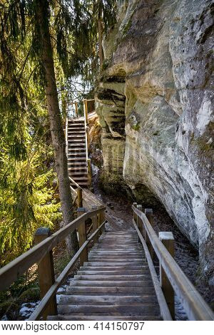 Tourist Trail With Wooden Pathwalk And Stairs Near Sandstone Cliffs. River Gauja In Latvia. The Clif