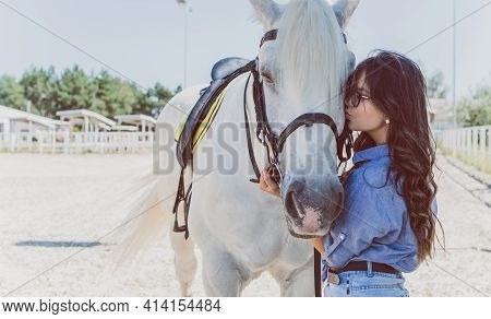 Young Pretty Woman Hugging Her Horse - Concept About Love Between People And Animals . Beautiful Lad