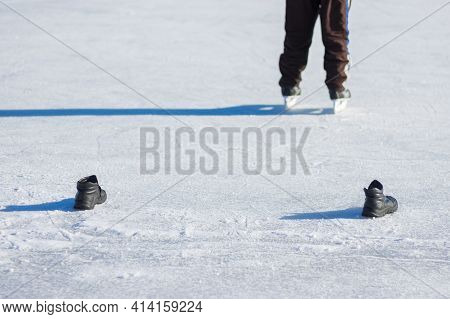 Pair Of Boots As A Goal Behind Goalkeeper In Amateur Hockey On A Frozen River Dnepr In Ukraine