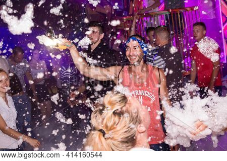 Belarus, Minsk - August 06, 2017: Happy Smiling Videographer With Gopro Camera On The Dance Floor Wi