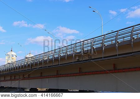 Cable Trays, Steel Racks And Ladders Supported Cables System Under The Bridge. Plastic Pipe For Rain