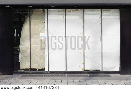 Closed Or Empty Shop Or Store Storefront With Blocked Windows