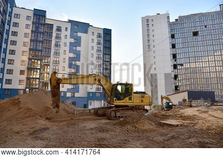 Excavator On Earthworks. Laying Heating Pipes And Stormwater In Trench. Installing Concrete Wells, H